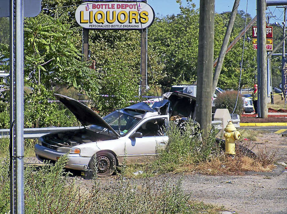 Part of Frontage Road in East Haven was shut down Wednesday after a silver car crashed into a utility pole. The accident near Home Depot completely closed a half-mile stretch of road for hours. Photo: Wes Duplantier — The New Haven Register