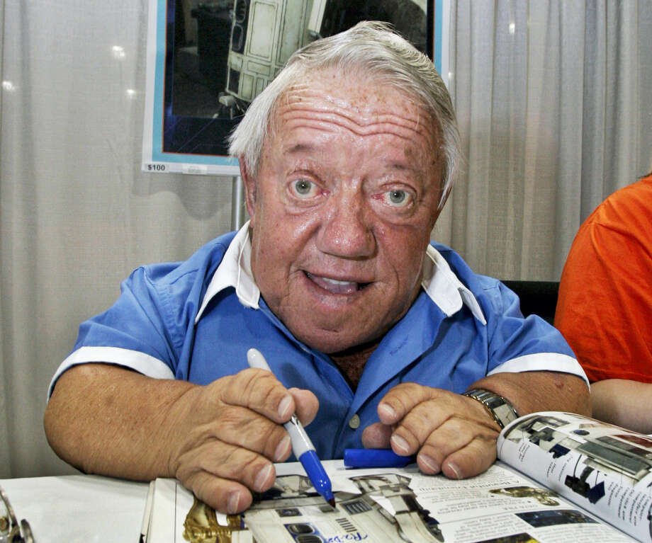 Actor Kenny Baker, who portrayed the R2-D2 in the first Star Wars movie, signs autographs at Star Wars Celebration IV, billed as the world's biggest Star Wars party, marking the 30th anniversary of the release of the first film in the Star Wars saga, at the Los Angeles Convention Center. Baker, 83, has died Saturday, Aug. 13, 2016. His niece, Abigail Shield, said he was found dead by a nephew on Saturday at his home in northwest England after a long illness. Photo: AP Photo — Reed Saxon   / AP2007