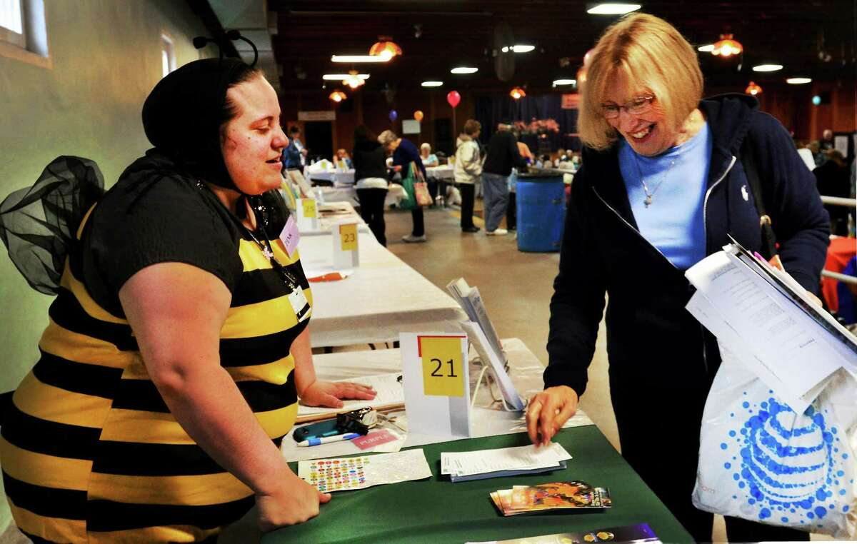 Krystle Fiengo, left, a pharmacy Tech at Griffin Pharmacy, gives health information to Charlotte Scrimente of Ansonia at the annual Senior Health Fair.