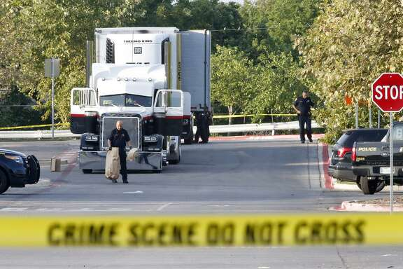 Law enforcement at the scene, where people were discovered inside a tractor trailer in a Walmart parking lot at IH35 South and Palo Alto Road, Sunday, July 23, 2017. Reports say that 8 were dead and several were in critical condition.