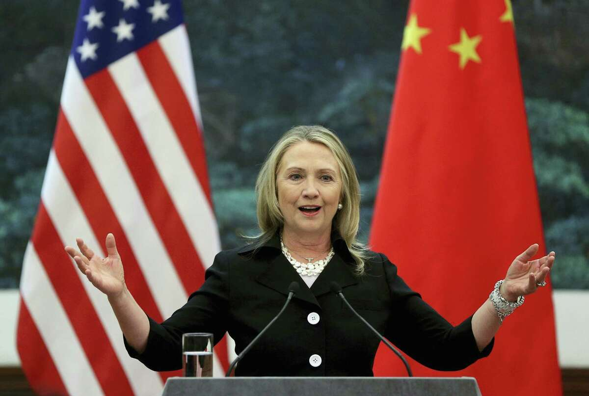 """FILE - In this Sept. 5, 2012 file photo, then U.S. Secretary of State Hillary Clinton speaks during her joint conference with Chinese Foreign Minister Yang Jiechi at the Great Hall of the People in Beijing when talks between Clinton and Chinese leaders failed to narrow gaps on how to end the crisis in Syria and how to resolve Beijing's territorial disputes with its smaller neighbors over the South China Sea. Clinton privately said the U.S. would """"ring China with missile defense"""" if the Chinese government failed to curb North Korea's nuclear program, a potential hint at how the former secretary of state would act if elected president. Clinton's remarks were revealed by WikiLeaks in a hack of the Clinton campaign chairman's personal account. (Feng Li/Pool Photo via AP, File)"""