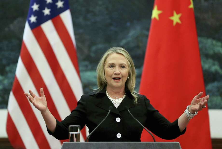 "FILE - In this Sept. 5, 2012 file photo, then U.S. Secretary of State Hillary Clinton speaks during her joint conference with Chinese Foreign Minister Yang Jiechi at the Great Hall of the People in Beijing when talks between Clinton and Chinese leaders failed to narrow gaps on how to end the crisis in Syria and how to resolve Beijing's territorial disputes with its smaller neighbors over the South China Sea. Clinton privately said the U.S. would ""ring China with missile defense"" if the Chinese government failed to curb North Korea's nuclear program, a potential hint at how the former secretary of state would act if elected president. Clinton's remarks were revealed by WikiLeaks in a hack of the Clinton campaign chairman's personal account. (Feng Li/Pool Photo via AP, File) Photo: AP / 2012 Getty Images"
