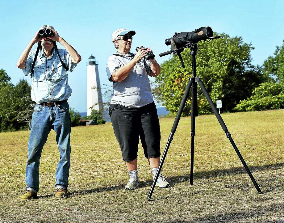 Volunteers Robin McAllister of Milford, left, and Lynn James of East Haven spot and count birds of prey over Lighthouse Point Park in New Haven Wednesday. Photo: Peter Hvizdak — New Haven Register    / ©2016 Peter Hvizdak