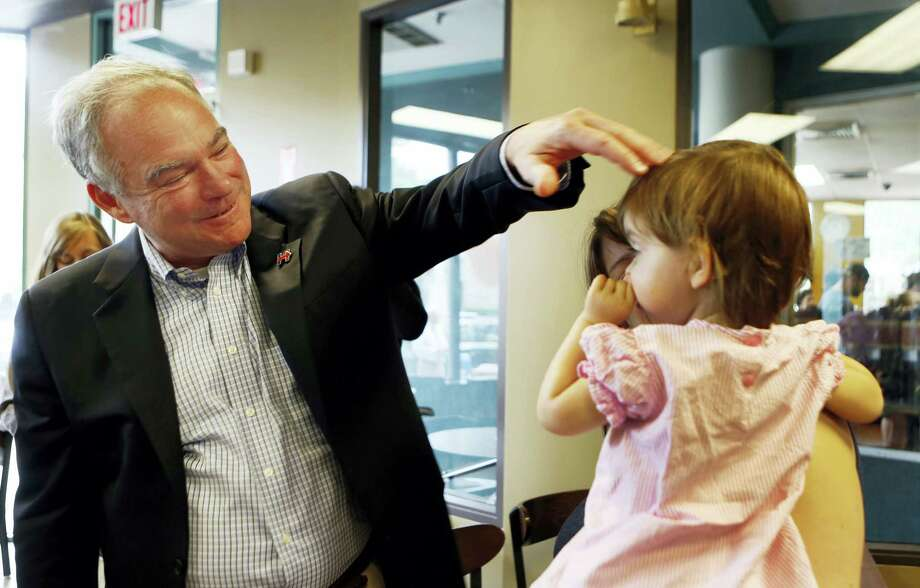 Democratic vice presidential candidate Sen. Tim Kaine, D-Va., talks with Sasha Hurwitz during a campaign stop at the Bridge Cafe Saturday, Aug. 13, 2016, in Manchester, N.H. Photo: AP Photo — Jim Cole / Copyright 2016 The Associated Press. All rights reserved. This material may not be published, broadcast, rewritten or redistribu