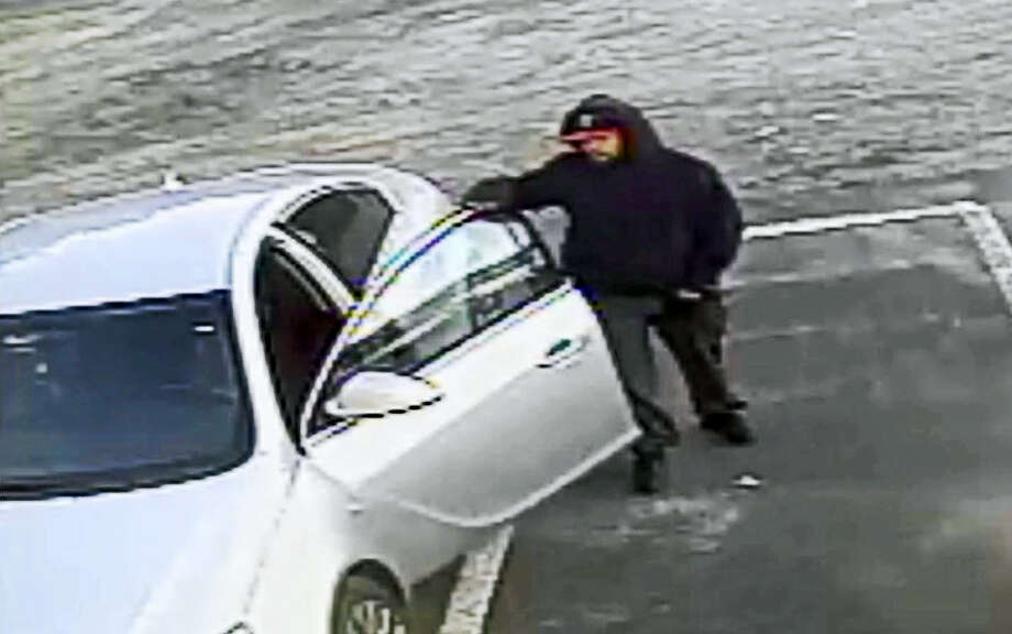 Police are looking for help identifying the suspect in this photo as well as the car he was driving. Photo: Courtesy Milford PD