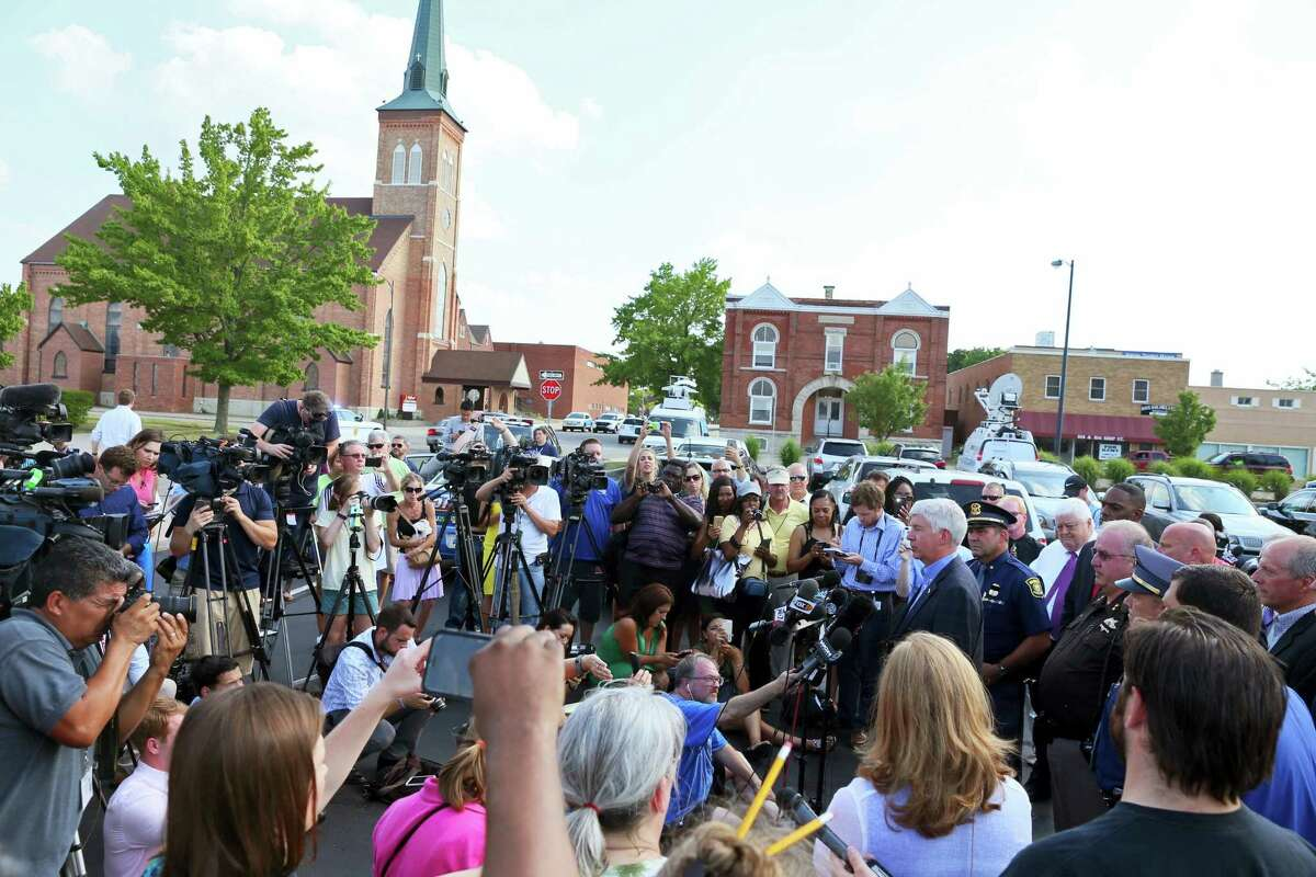 Michigan Governor Rick Snyder speaks at a press conference near the Berrien County Courthouse on Monday, July 11, 2016, in St. Joseph, Mich. A jail inmate wrested a gun from an officer and opened fire inside the county courthouse, killing two bailiffs before being shot and killed by other officers. Larry Darnell Gordon, 44, who was locked up on several felony charges, was being moved from a cell for a courtroom appearance when a fight occurred and he was able to disarm an officer, Sheriff Paul Bailey said.