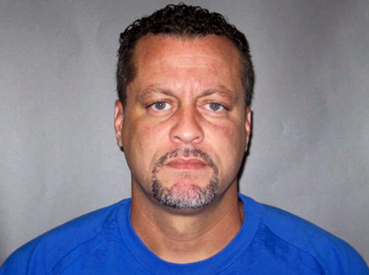 This undated photo provided by the Michigan Department of Corrections shows Larry Darnell Gordon. The jail inmate trying to escape from a western Michigan courthouse wrested a gun from an officer, killing a few bailiffs and injuring a few more people before he was fatally shot by other officers, a sheriff said.