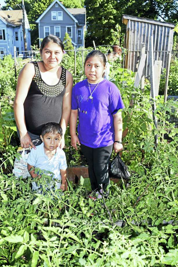 Rocio Rodriguez in her garden alongside her children Amy and Leonardo Rodriguez Photo: Contributed Photo