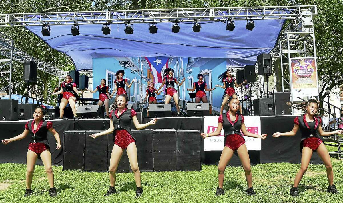 The 2Dance dance group of Hartford performs a Hispanic dance medley on the New Haven Green Saturday, Aug. 13, 2016 during the Puerto Ricans United Inc. presentation of Fiestas Patronales de New Haven, a Puerto Rican Festival honoring the City of San Juan on the New Haven Green.
