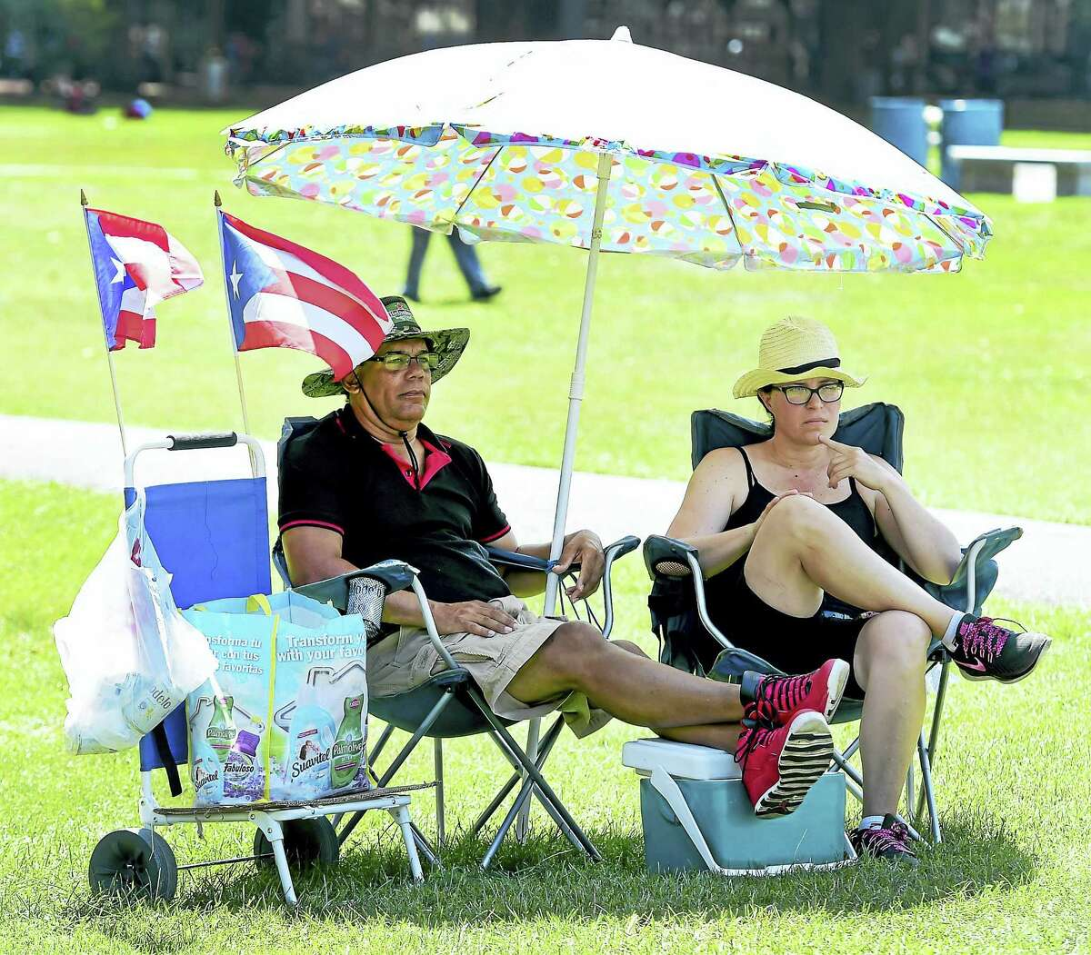 Luis Nieves, left, and friend Milagron Rios, on the New Haven Green Saturday, Aug. 13, 2016 during the Puerto Ricans United Inc. presentation of Fiestas Patronales de New Haven, a Puerto Rican Festival honoring the City of San Juan on the New Haven Green.