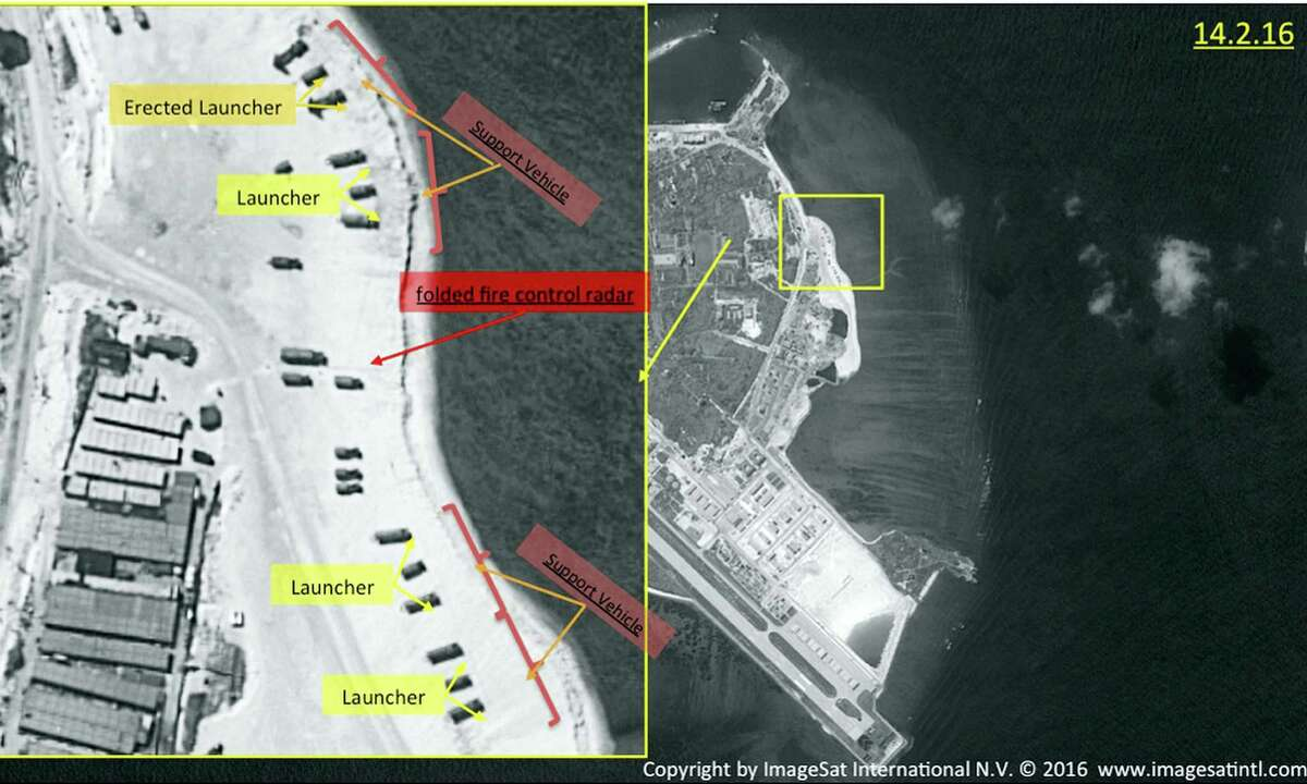 This image with notations provided by ImageSat International N.V., on Wednesday, Feb. 17, 2016, shows satellite images of Woody Island, the largest of the Paracel Islands, in the South China Sea. A tribunal ruled in a sweeping decision Tuesday, July 12, 2016, that China has no legal basis for claiming much of the South China Sea and had aggravated the seething regional dispute with its large-scale land reclamation and construction of artificial islands that destroyed coral reefs and the natural condition of the disputed areas.