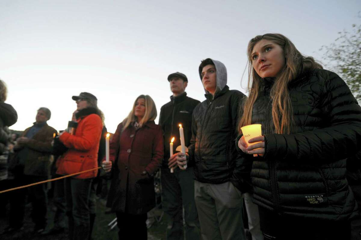 Mourners hold candles Monday, Oct. 10, 2016, during a vigil attended by about 1,000 at Harwood Union High School in Duxbury, Vt., held for the teenaged victims killed in Saturday night's crash on Interstate 89 in Williston. Four of the five teens killed by the wrong-way driver were students at Harwood. The fifth student killed was from Fayston and attended a private school in New Hampshire.
