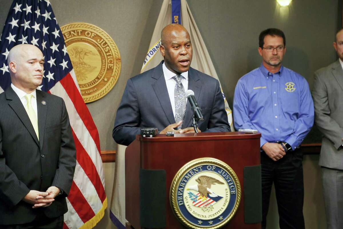 FBI Special Agent in Charge Eric Jackson talks about the FBI's roll in stopping a bomb plot. Acting U.S. Attorney Tom Beall, left, announced Friday a major federal investigation stopped a domestic terrorism plot by a militia group to detonate a bomb at a Garden City apartment complex where a number of Somalis live. Two Liberal men and a Dodge City resident were arrested and charged in federal court with domestic terrorism charges, Beall told reporters at a news conference in downtown Wichita.