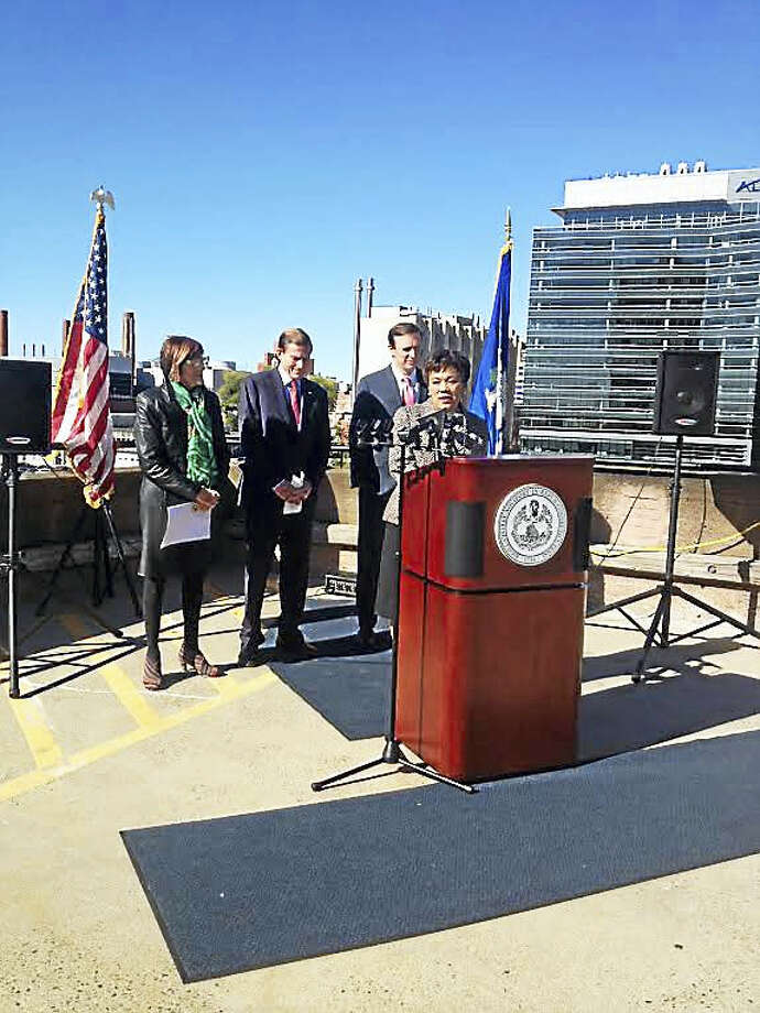 From left, U.S. Rep. Rosa DeLauro, D-3; U.S. Sen. Richard Blumenthal; and U.S. Sen. Chris Murphy listen to New Haven Mayor Toni Harp thank them for $20 million TIGER grant. Photo: MARY O'LEARY — NEW HAVEN REGISTER