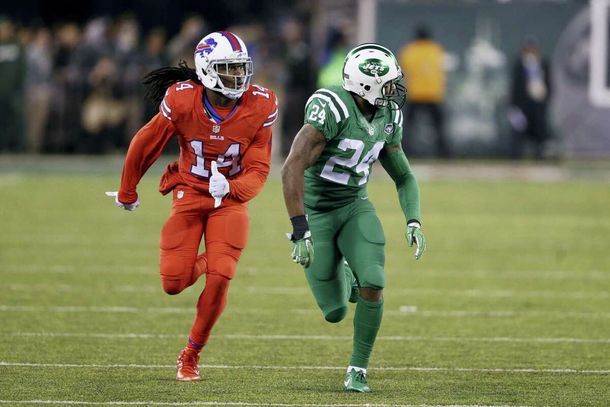 "In this Nov. 12, 2015 photo, Buffalo Bills wide receiver Sammy Watkins, left, is defended by New York Jets cornerback Darrelle Revis during the first half of an NFL football game, in East Rutherford, N.J. The NFL isn't colorblind to the concerns of its TV audience regarding the ""Color Rush"" alternate uniforms the Bills and Jets will wear Thursday night Sept. 14, 2016."