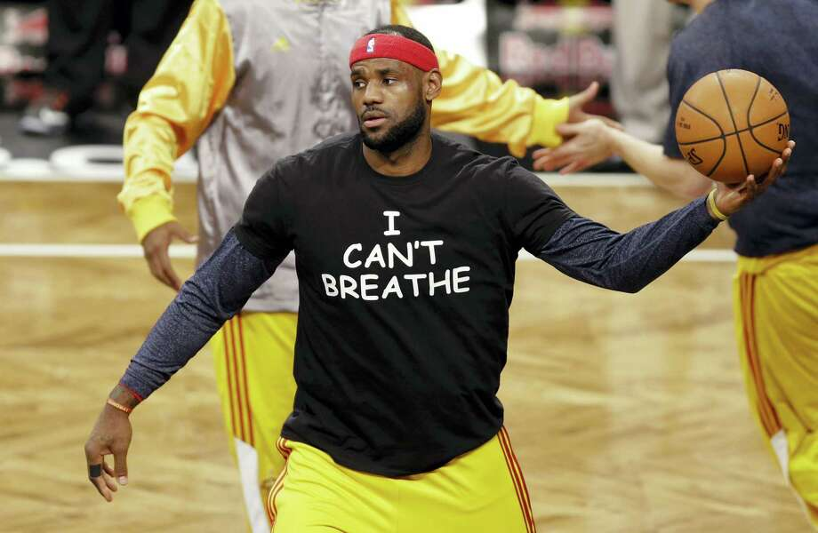 "In this Dec. 8, 2014, photo, Cleveland Cavaliers' LeBron James wears a T-shirt reading ""I Can't Breathe,"" during warms up before a game. Celebrities have long played a significant role in social change. Photo: THE ASSOCIATED PRESS FILE PHOTO   / Copyright 2016 The Associated Press. All rights reserved. This material may not be published, broadcast, rewritten or redistribu"