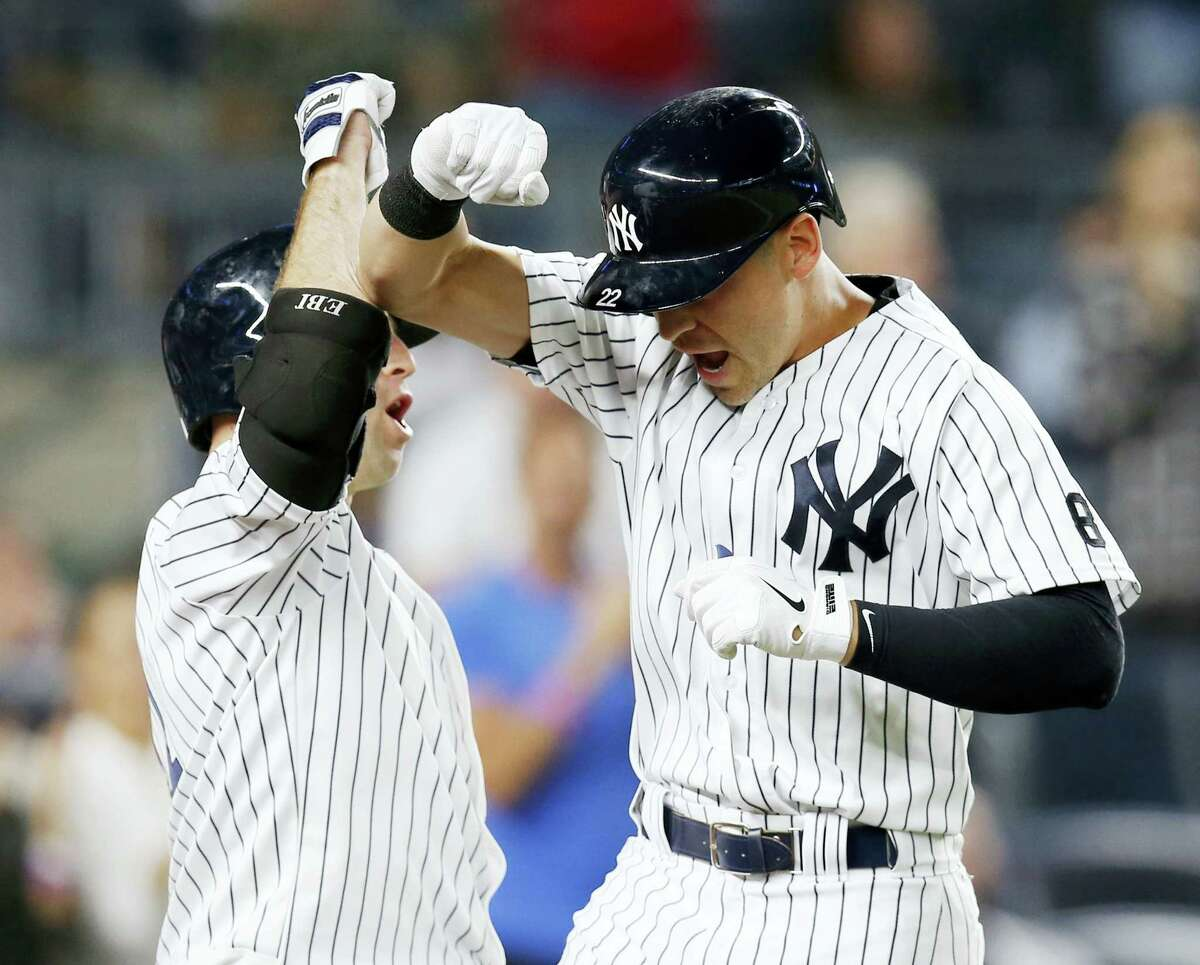 New York'S Brett Gardner, left, celebrates with pinch-hitter Jacoby Ellsbury after Ellsbury' seventh-inning solo home run Tuesday night. The Yankees shut out the Dodgers 3-0.