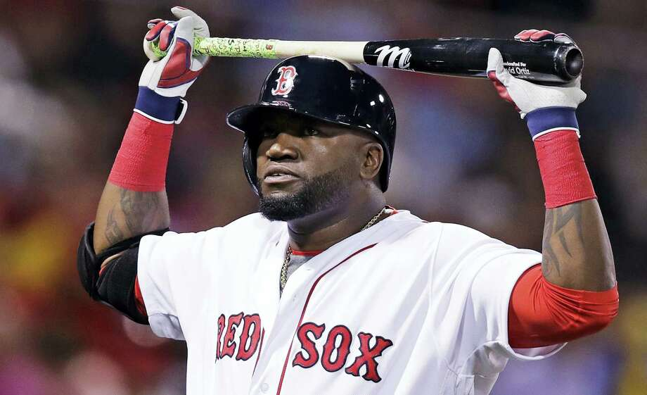 Boston Red Sox designated hitter David Ortiz rests his bat on his helmet after grounding out with two men on base during the second inning against the Baltimore Orioles at Fenway Park Tuesday. The Orioles won 6-3. Photo: CHARLES KRUPA — THE ASSOCIATED PRESS   / Copyright 2016 The Associated Press. All rights reserved.