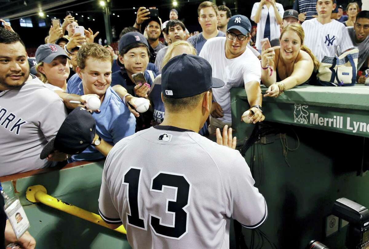 MICHAEL DWYER - THE ASSOCIATED PRESS New York's Alex Rodriguez greets fans as he enters the dug out following a baseball game against the Boston Red Sox in Boston, Thursday. The Yankees won 4-2.