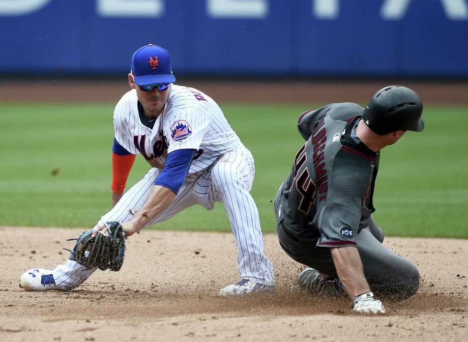 Arizona Diamondbacks Paul Goldschmidt (44) beats the tag of New York Mets shortstop baseman Matt Reynolds (15) to steal second base safely in the fifth inning Thursday in New York. The Diamondbacks won 9-0. Photo: Kathy Kmonicek — The Associated Press   / FR170189 AP