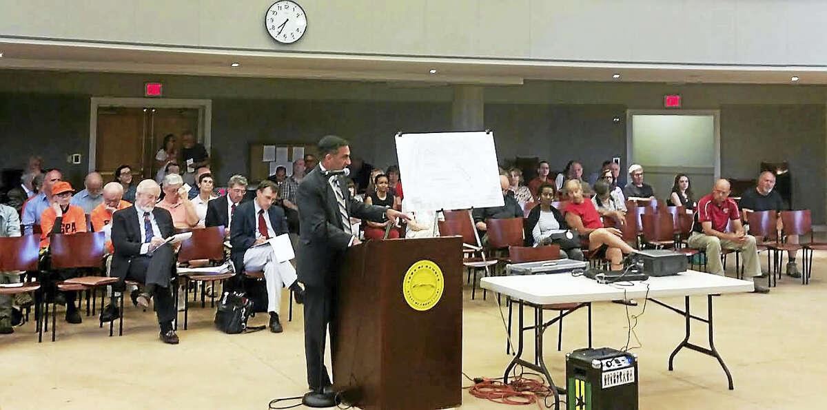 Quinnipiac University attorney Bernard Pelligrino presents the school's revised plans for upgraded athletic fields on Mount Carmel Avenue.