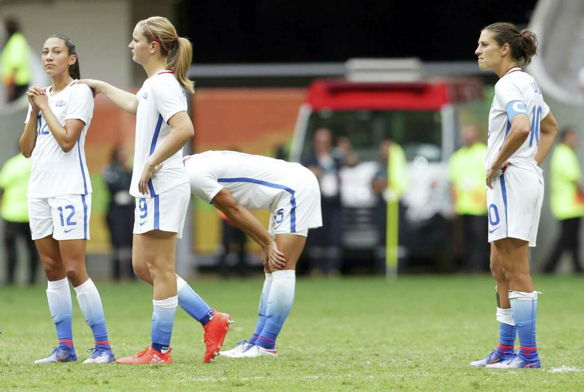 United States' players react during the penalty shoot-out against Sweden on Friday.