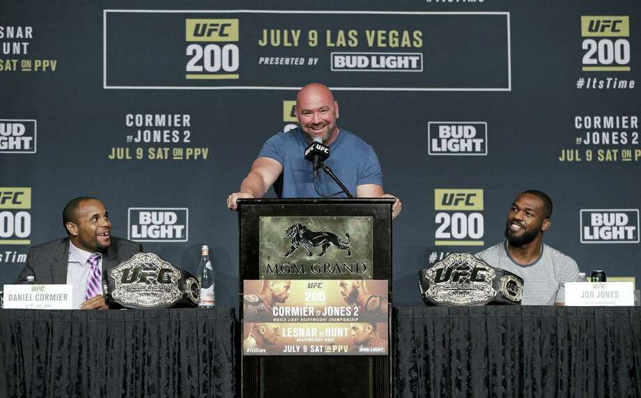 Dana White, center, will stay on to run UFC after it was sold for $4 billion to a group led by Hollywood talent agency WME-IMG. Photo: John Locher — The Associated Press   / Copyright 2016 The Associated Press. All rights reserved. This material may not be published, broadcast, rewritten or redistribu