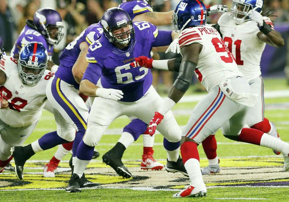 Minnesota Vikings guard Brandon Fusco (63) looks to block Giants defensive end Jason Pierre-Paul, right, during a recent game. Photo: Jim Mone — The Associated Press   / AP