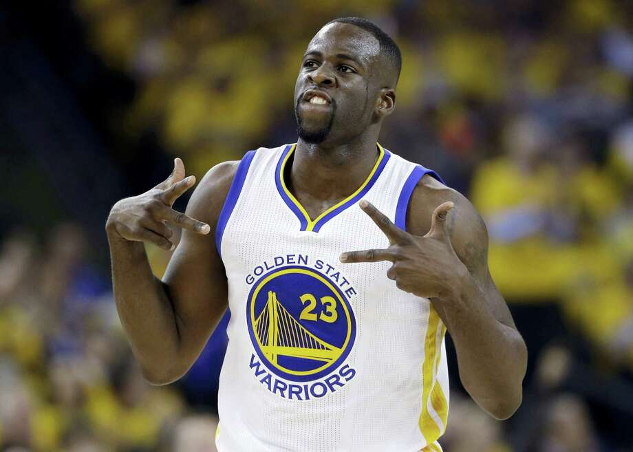 In this April 27, 2016 photo, Golden State Warriors' Draymond Green celebrates after scoring against the Houston Rockets during the first half in Game 5 of a first-round NBA basketball playoff series in Oakland, Calif. Photo: AP Photo/Marcio Jose Sanchez, File   / Copyright 2016 The Associated Press. All rights reserved. This material may not be published, broadcast, rewritten or redistribu