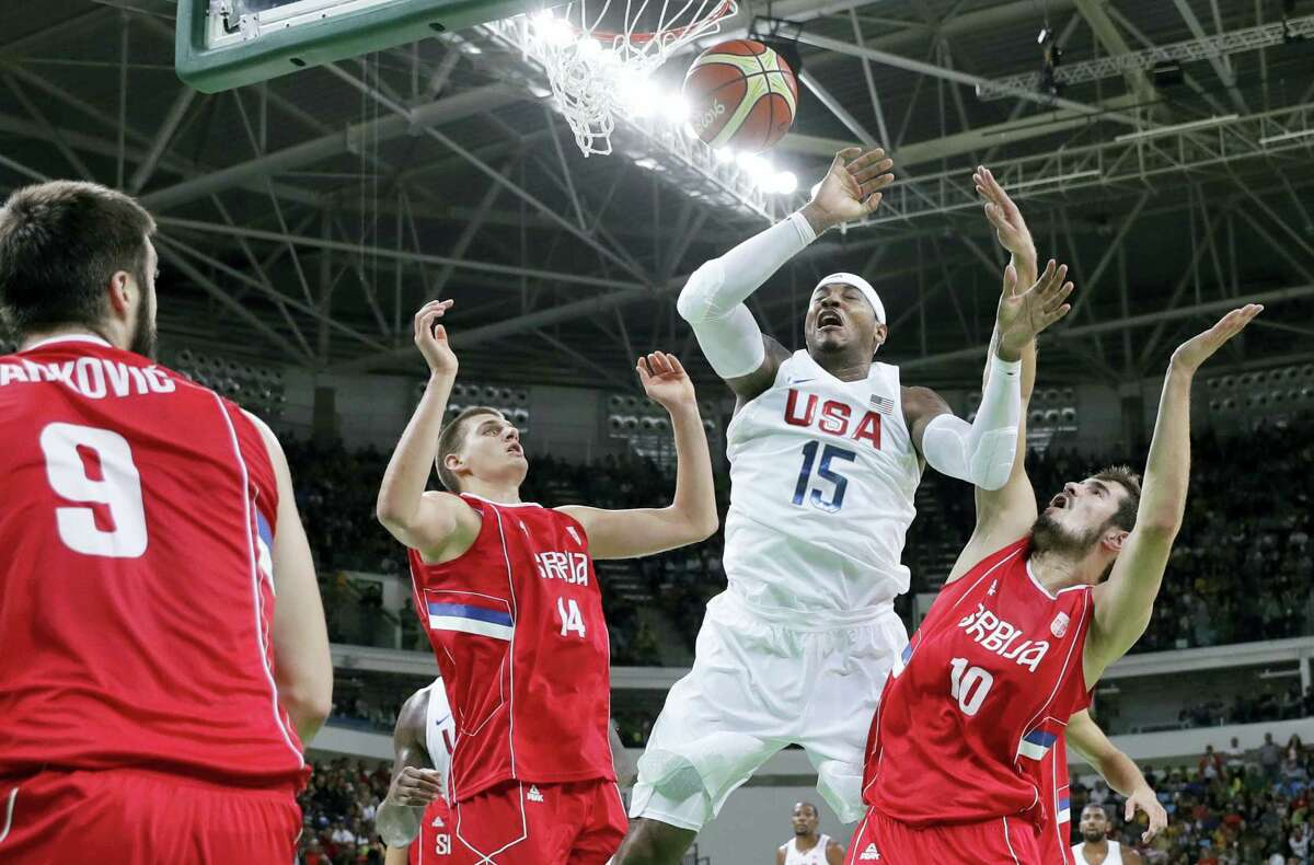 Carmelo Anthony (15) fouled as he drives to the basket on Friday.