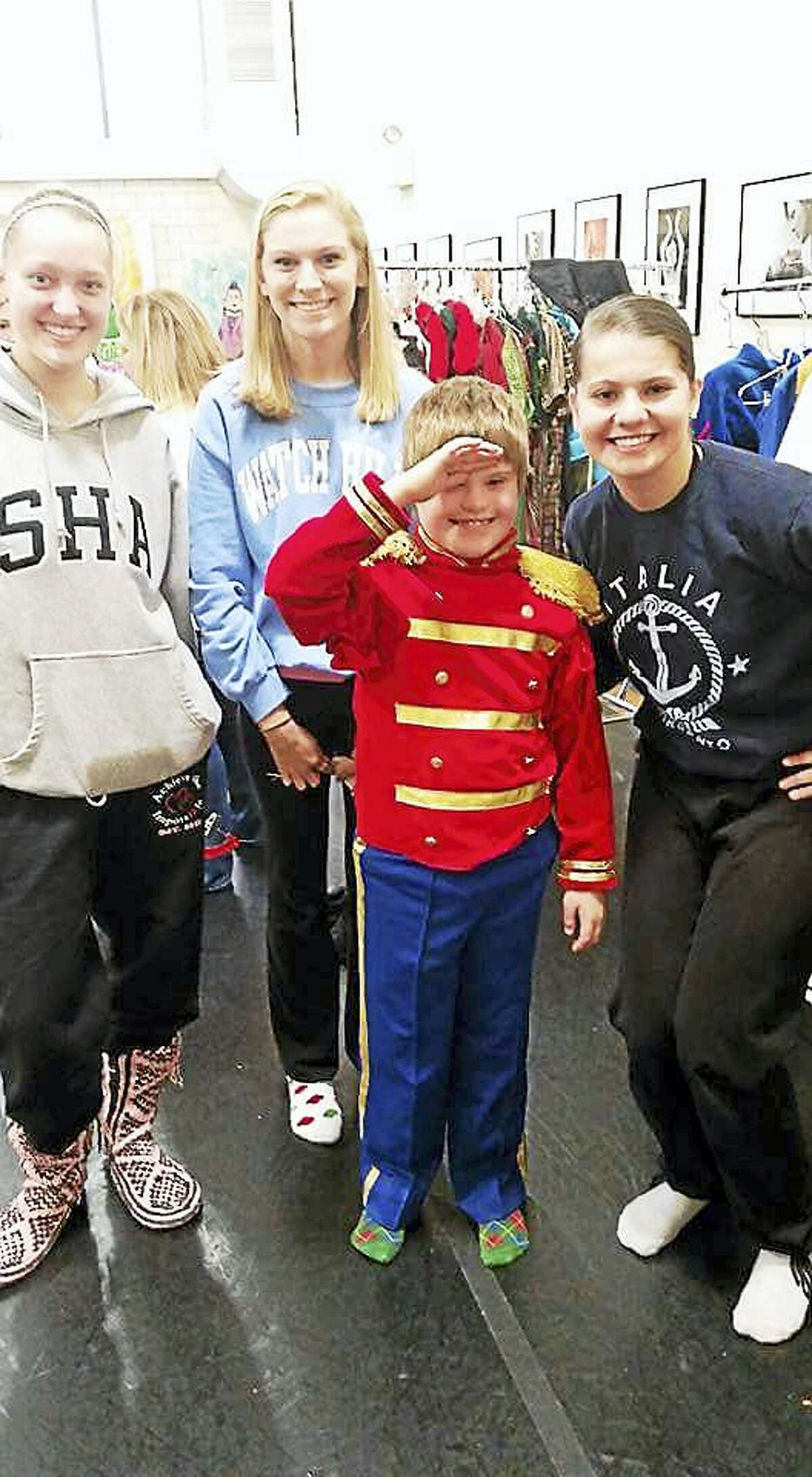Contributed photo From left: mentors Katerina Bilcheck and Rylee Doheny, adaptive ballet student Marshall Firmender, dressed as a soldier for last year's production and former mentor Kristen Faraclas.