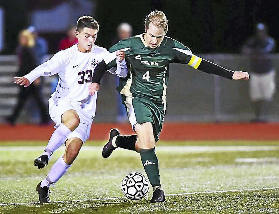 Cheshire senior midfielder Sean Black battles Notre Dame (WH) senior Nicholas Copenhaver for possession of the ball Wednesday in a 0-0 tie at Alumni Field at the David B. Maclary Athletic Complex at Cheshire High School. Photo: (Catherine Avalone/New Haven Register)