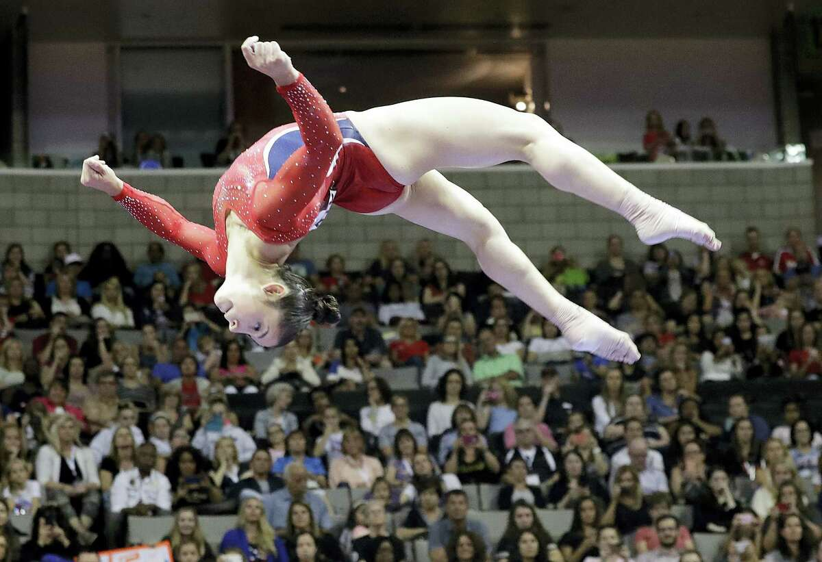 Aly Raisman competes on the balance beam during the women's U.S. Olympic gymnastics trials.