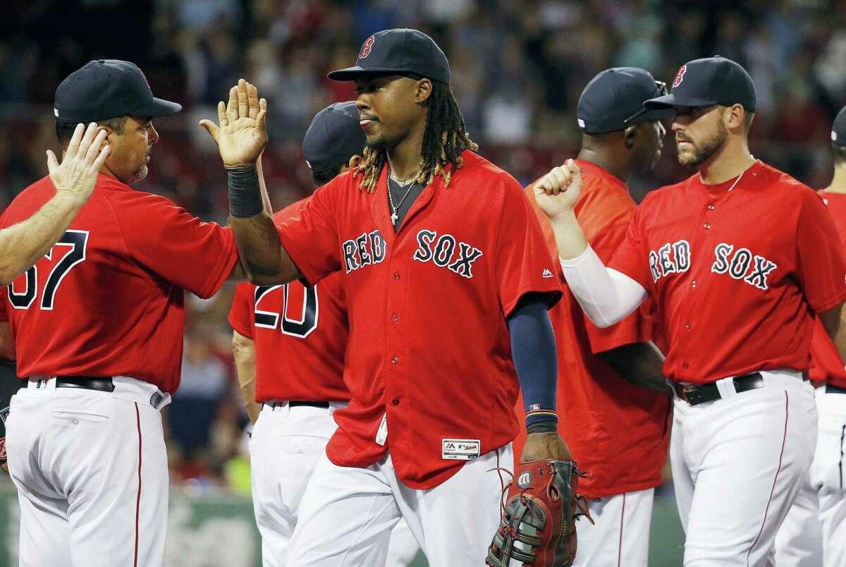 Hanley Ramirez, center, celebrates with teammates after the Red Sox beat the Diamondbacks on Friday.