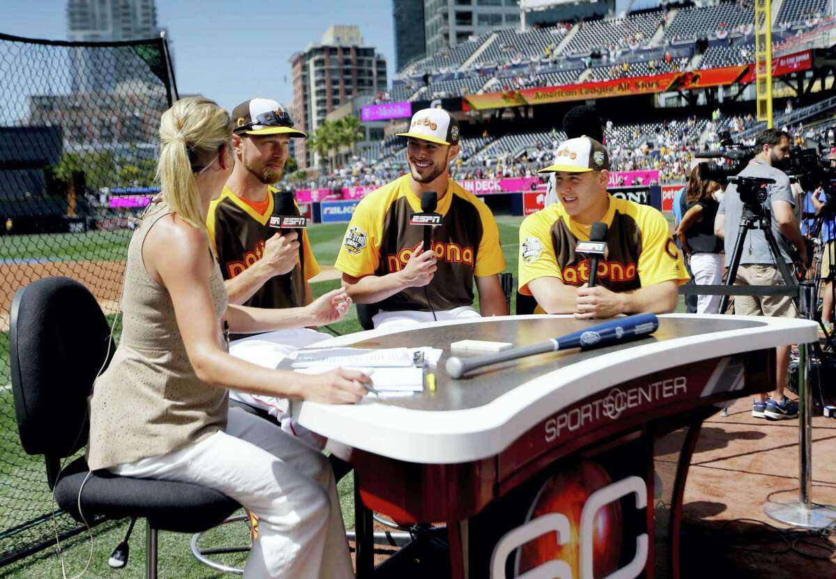 Anthony Rizzo, right, Kris Bryant, center, and Ben Zobrist, all of the Chicago Cubs, are interviewed prior to Monday's Home Run Derby.