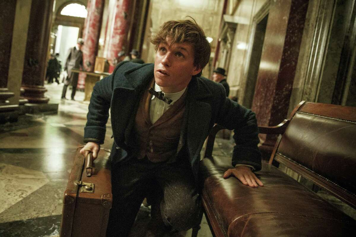 "This image released by Warner Bros. Entertainment shows Eddie Redmayne in a scene from, ""Fantastic Beasts and Where to Find Them."" (Jaap Buitendijk/Warner Bros. via AP)"