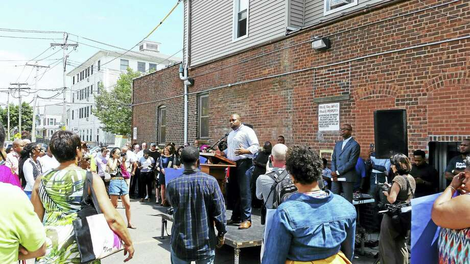 State Sen. Gary Winfield, D-New Haven, speaks at the Stand Together Rally Sunday at Varick Memorial AME Zion Church. Photo: Helen Bennett — New Haven Register