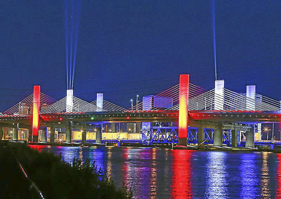 The new Pearl Harbor Memorial Bridge was illuminated in red, white and blue for the July 4th holiday this year. Photo: John Vanacore — For The Register   / (c)John H.Vanacore/Register