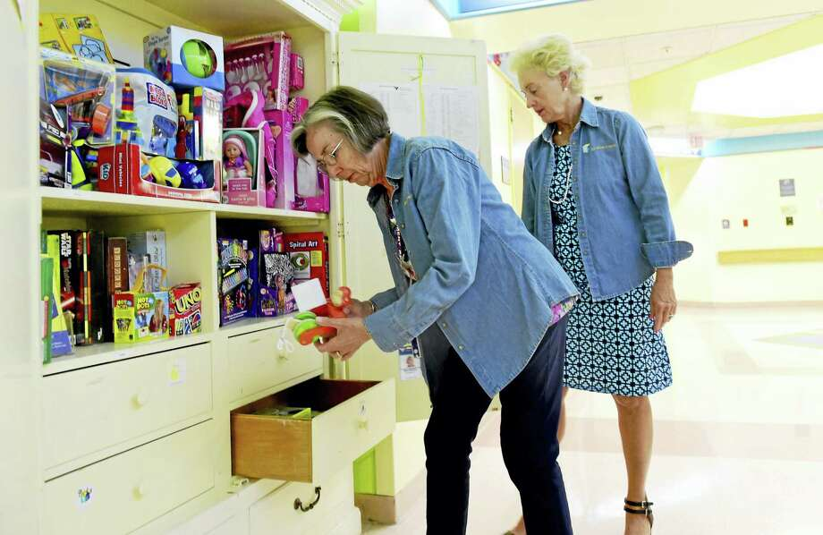 Maureen Herbert, left, and Diane Petra, co-chairwomen of the Yale-New Haven Children's Hospital Auxiliary Toy Closet at a Toy Closet on the 7th floor of the Yale-New Haven Children's Hospital. Photo: Peter Hvizdak - New Haven Register   / ©2016 Peter Hvizdak