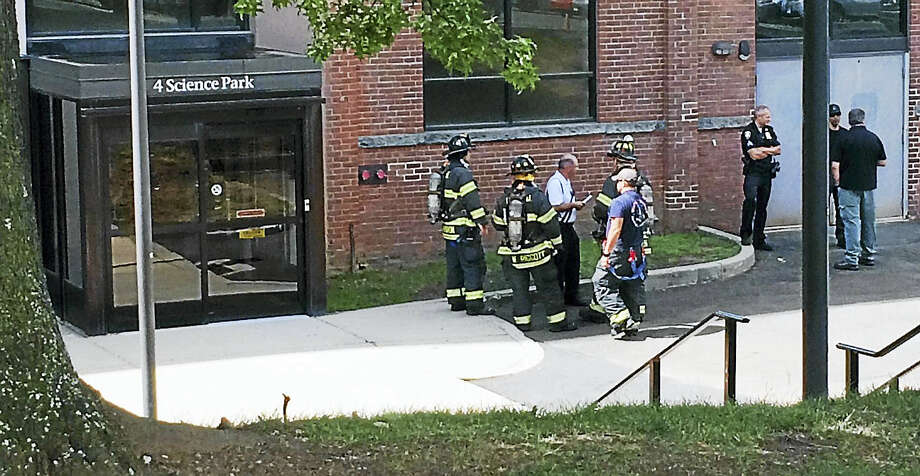 New Haven firefighters, police officers and several other agencies responded to a lab accident Monday morning at the Science Park in New Haven. Photo: Wes Duplantier — New Haven Register
