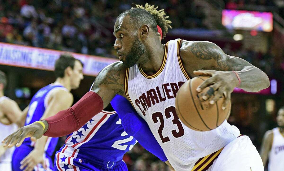 Cleveland Cavaliers forward LeBron James (23) drives on Phildelphia 76ers forward James Webb III (23) in the first half of an NBA preseason basketball game on Oct. 8, 2016 in Cleveland.