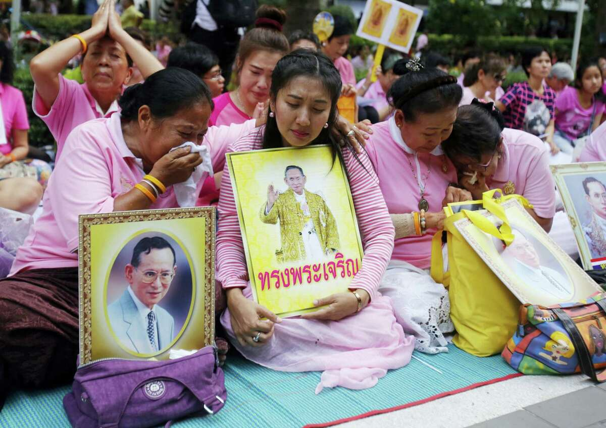 Thais cry as they pray for Thailand's King Bhumibol Adulyadej at Siriraj Hospital where the king is being treated in Bangkok, Thailand on Oct. 13, 2016. The royal palace said in a statement late Wednesday that the 88-year-old king's blood pressure had dropped, his liver and kidneys were not working properly and he remained on a ventilator.