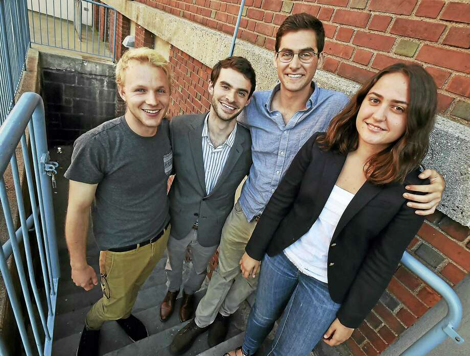 Co-founders of Connecticut Bail Fund are Patrick Sullivan; Scott Greenberg, a researcher at the Yale School of Medicine; Brett Davidson, and Simone Seiver, shown outside the Fair Haven Branch Library in New Haven following a community planning meeting. Photo: Catherine Avalone — New Haven Register    / New Haven RegisterThe Middletown Press
