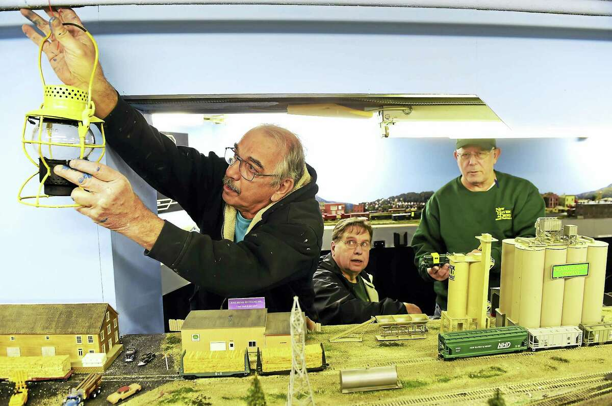 Bob Savarese, Ken Lord and Howard Williams, left to right, of the New Haven and Derby Model Railroad Club in with the club's model railroad display in the basement of the Academy Building of the Orange Historical Society Friday, Dec. 2, 2016. The club will open its free model railroad exhibit after the Orange Christmas Tree lighting ceremony Sunday, Dec. 4 at the Orange Historical Society.