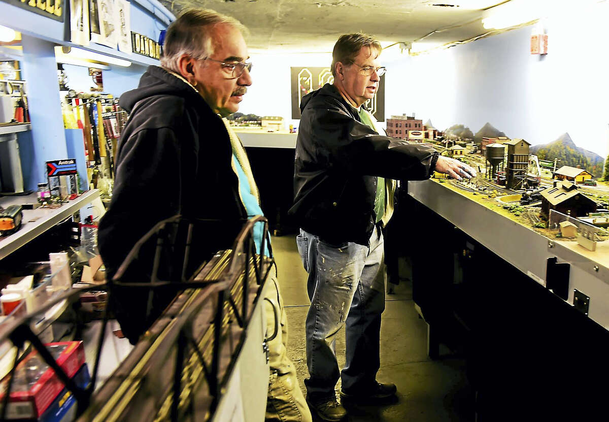 Bob Savarese, left, and Ken Lord of the New Haven and Derby Model Railroad Club in with the club's model railroad display in the basement of the Academy Building of the Orange Historical Society Friday, December 2, 2016. The club will open its free model railroad exhibit after the Orange Christmas Tree lighting ceremony Sunday December 4 at the Orange Historical Society.