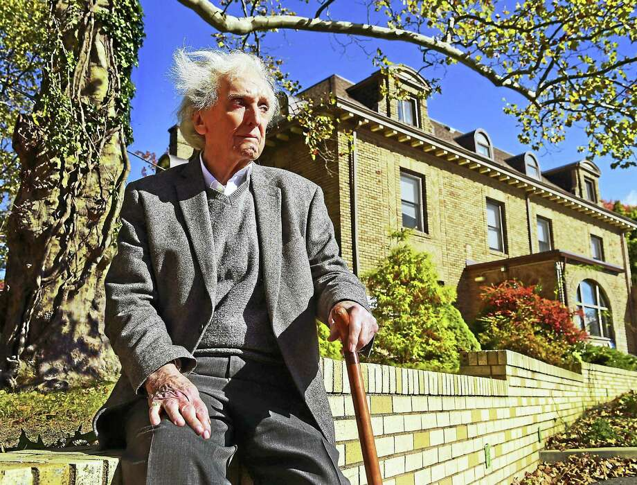 Entrepreneur Jimmy Miller of Oxford, 90, who had a rocky start in life, sits at the site of the former orphanage, the St. Francis Home for Children on Prospect Street in New Haven where he was brought up. Miller has raised millions of dollars to aid charitable causes for children. Photo: Peter Hvizdak — New Haven Register   / ?2016 Peter Hvizdak