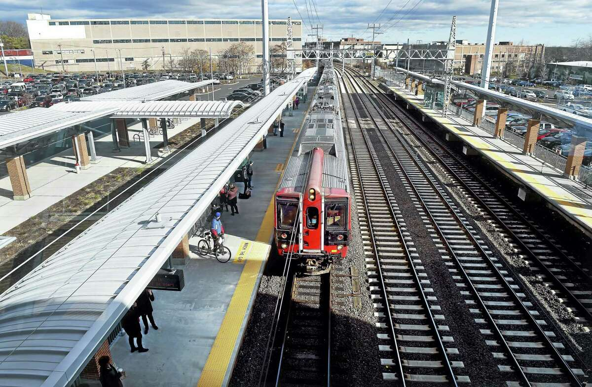 A Metro-North commuter train picks up passengers at the West Haven train station on Saturday.
