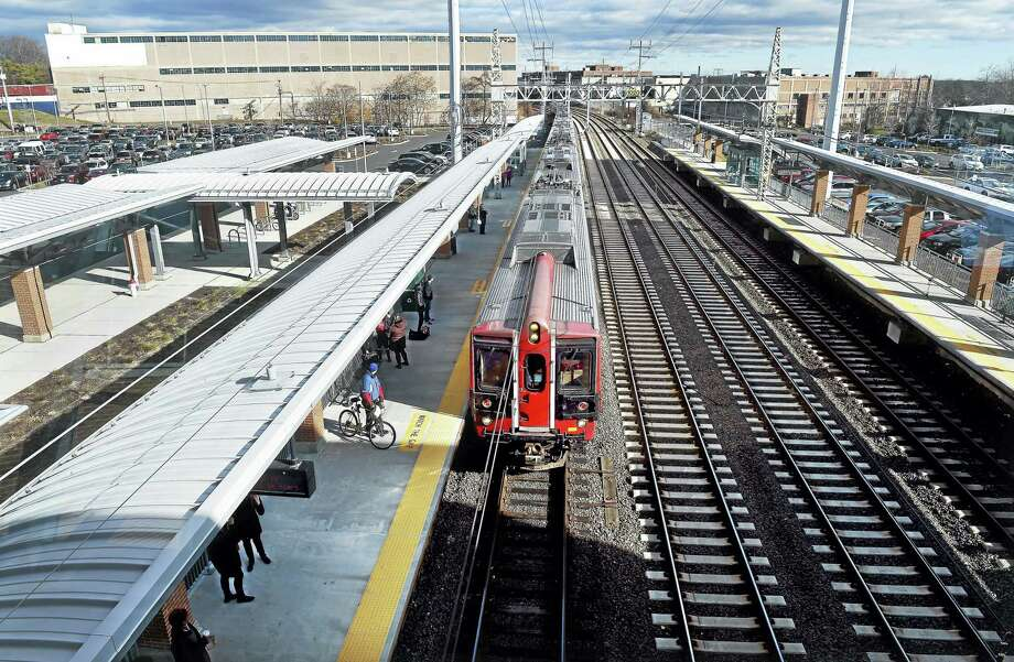 A Metro-North commuter train picks up passengers at the West Haven train station on Saturday. Photo: Arnold Gold — New Haven Register