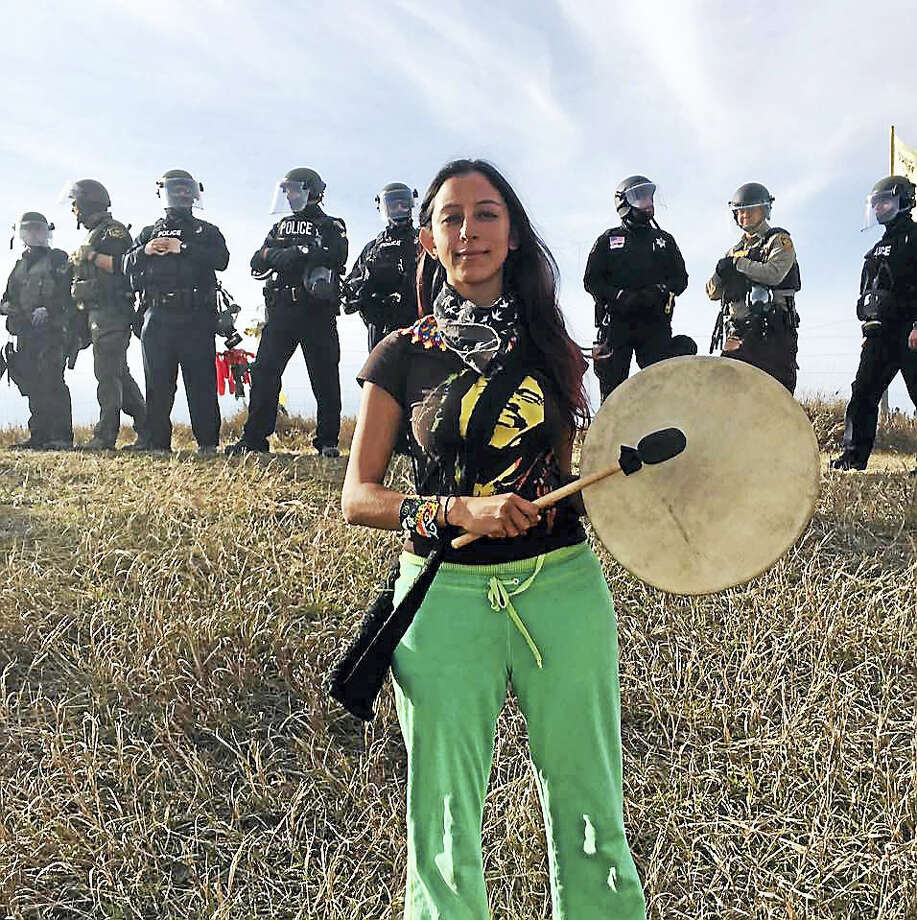 Lolly Berger takes her stand at Standing Rock on Oct. 27 just before police raided the North Camp. Photo: Contributed Photo