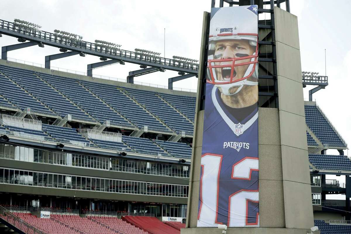 A oversized banner of New England Patriots' Tom Brady is attached to the lighthouse at an entrance to Gillette Stadium.